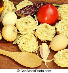 tagliatelle pasta ingredients on wooden board - tagliatelle...