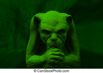 Green gargoyle figure on grunge background