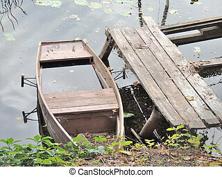 boat dock - submerged boat at boat dock