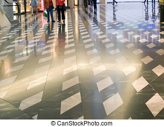 Shopping mall - Patterned shiny floor inside of shopping...