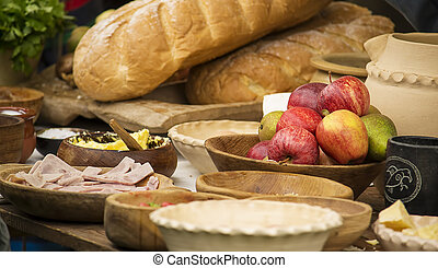Medieval feast - Medieval style food and wooden bowls on the...