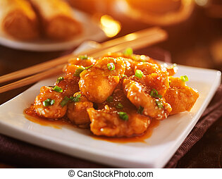 plate of chinese sesame chicken take out