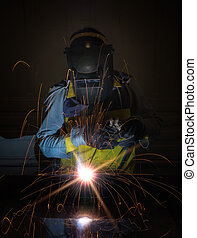 worker work hard with welding process in production plant