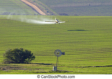 Crop spraying - Plane spraying crops in Western Cape, South...