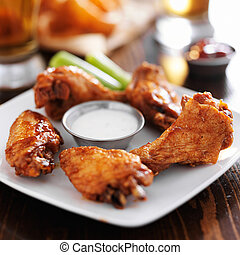 buffalo barbecue hot chicken wings around ranch sauce with...