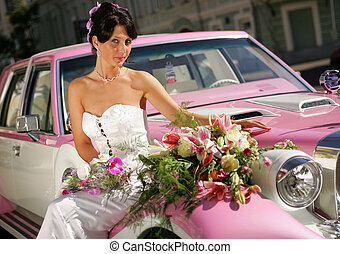 Bride on pink limousine - Pretty young adult bride sat on...