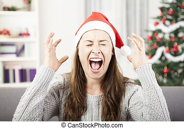 young girl shout because of christmas stress - young girl...