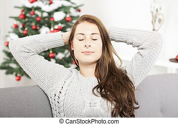 young girl is relaxing after christmas stress - young cute...