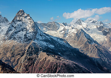 Dombai Scenery of rockies in Caucasus region in Russia -...