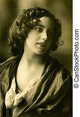 Vintage portrait of a young women. The shot was taken around...
