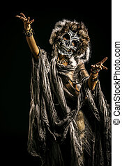 halloween skull - Frightening female wearing mask of skull....