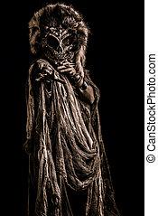 mystical scene - Frightening female wearing mask of skull....