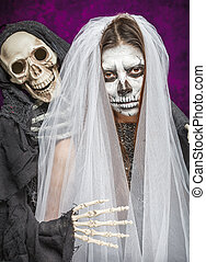 Young woman a bride in a veil day of the dead mask skull...