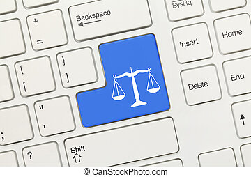 White conceptual keyboard - Law symbol (blue key) - Close-up...