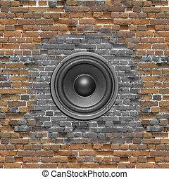 audio speaker on brick wall