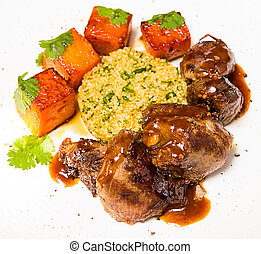 Organic meat of lamb cooked with slices pumpkin and quinoa...