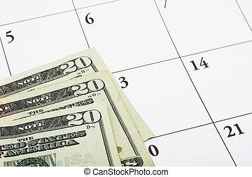 Financial Planning - Three twenty dollar bills sitting on a...