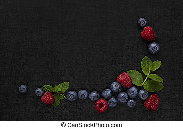 Berry fruit background with copyspace. Raspberries and...