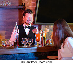 Alcohol - Bartender is making cocktail at bar counter