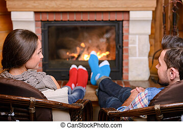 Fireplace - Christmas Couple. Happy Smiling Family at home...