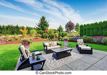 Impressive backyard landscape design with patio area -...