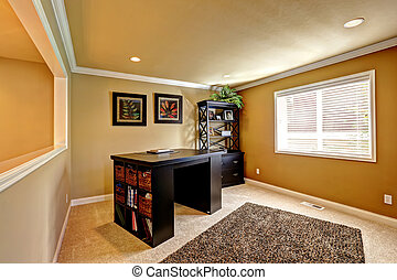 Office area with dark brown furniture