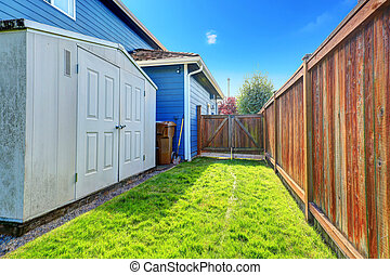 Small backyard area with shed - Fenced backyard area with...