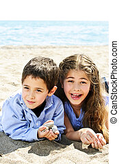 Brother and sister at beach - Portrait of brother and sister...