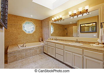 Luxury bathroom interior with tile trim and big vanity...
