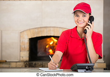 Pizzeria - Portrait of happy delivery woman of pizza holding...