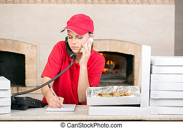 Pizzeria - Delivery woman of pizza on the phone ang several...