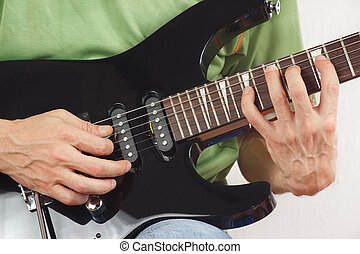 Hands of guitarist put guitar chords