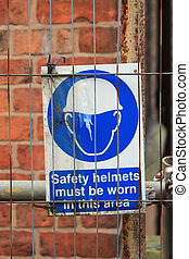 Sign indicating safety helmets must