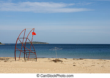 end of season - 1 - red flag on the tower on deserted beach...