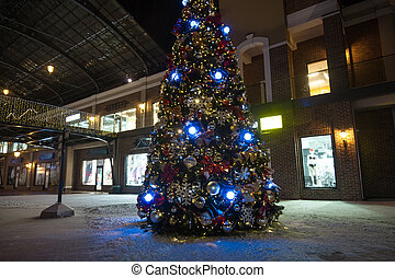 christmas tree in lights on street at night - Outdoor shot...