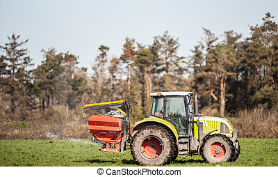 Tractor spraying rural field