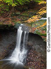 Ohios Blue Hen Falls - Blue Hen Falls spills over a rock...
