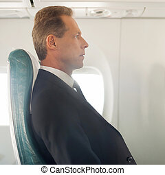 Business trip Side view of confident mature businessman...