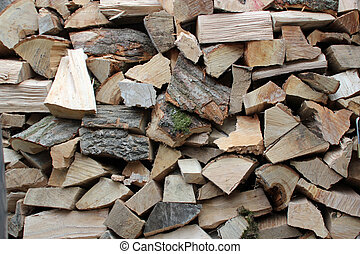 Background logs - Background of a stack of logs symbolizing...