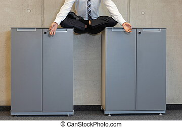 businessman in lotus pose - meditating businessman in lotus...
