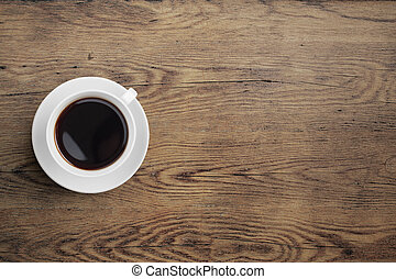 Black coffee cup on old wooden table top view - Black coffee...