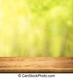 wood table on green summer forest background