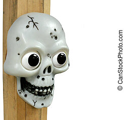 Scary skull - A plastic skull with beady eyes attached to a...