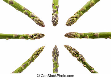 Eight Asparagus Spears Pointing at the Middle - Eight green...