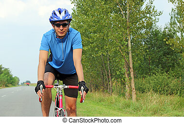 male cyclist on a race bike portrait