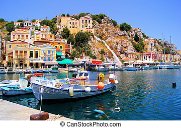 Colorful Greek islands - Beautiful boat lined harbor at...