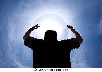 person with hands up around Halo - sunlight phenomenon