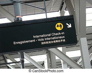 check-in sign at an airport