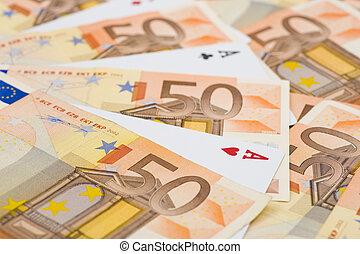 aces between euro bills - aces between lots of 50 euro...