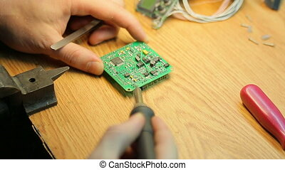 Job soldering close-up - Scientist working soldering iron...